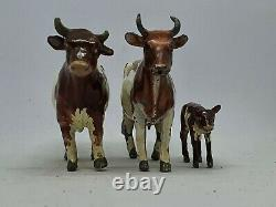 Britains hollow-cast lead 54mm Ayrshire bull (#784) cow (#785) and calf (#786)